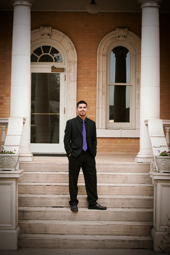 Senior man outside historic building.