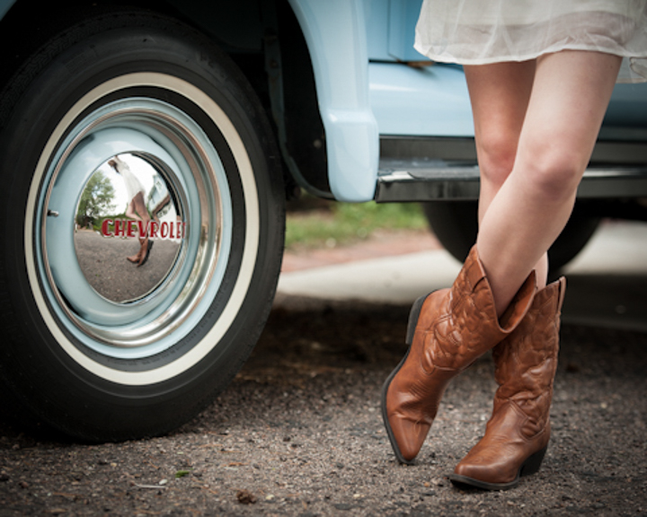 Senior girl with cowboy boots.