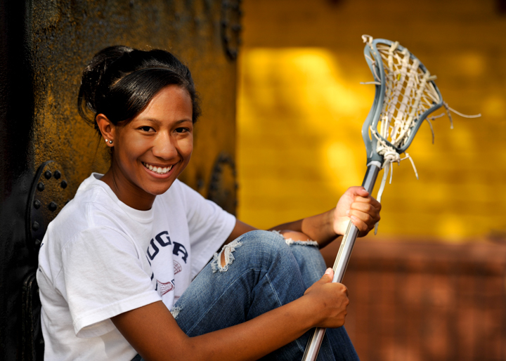Senior with lacrosse stick.